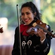 Smiling woman holding a violin