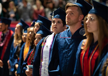 Students in graduation caps and robs at commencement
