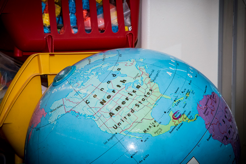 Close up picture of a globe in a classroom.