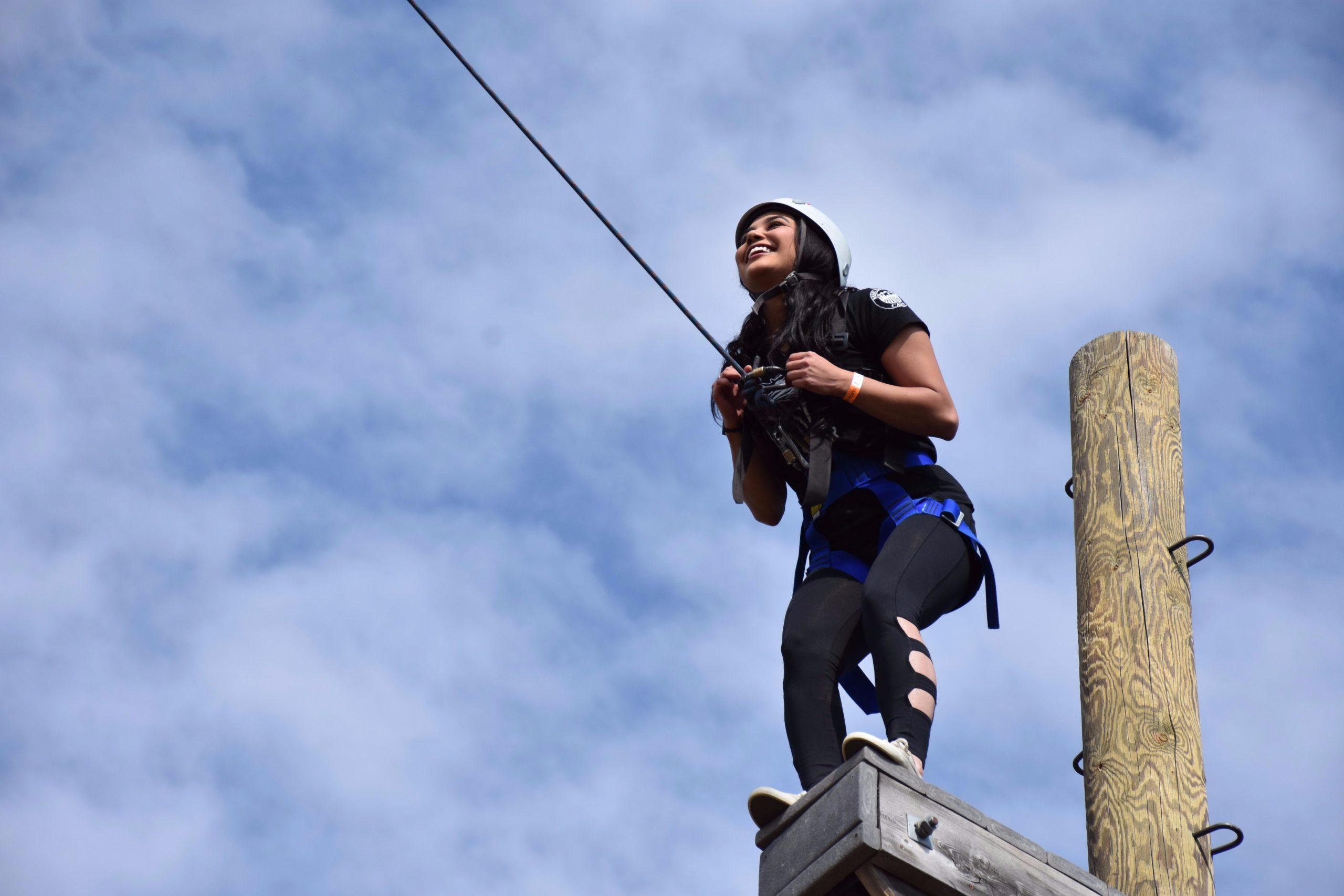 CAMP student at ropes course