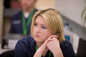 Student listening to a lecture in the classroom.