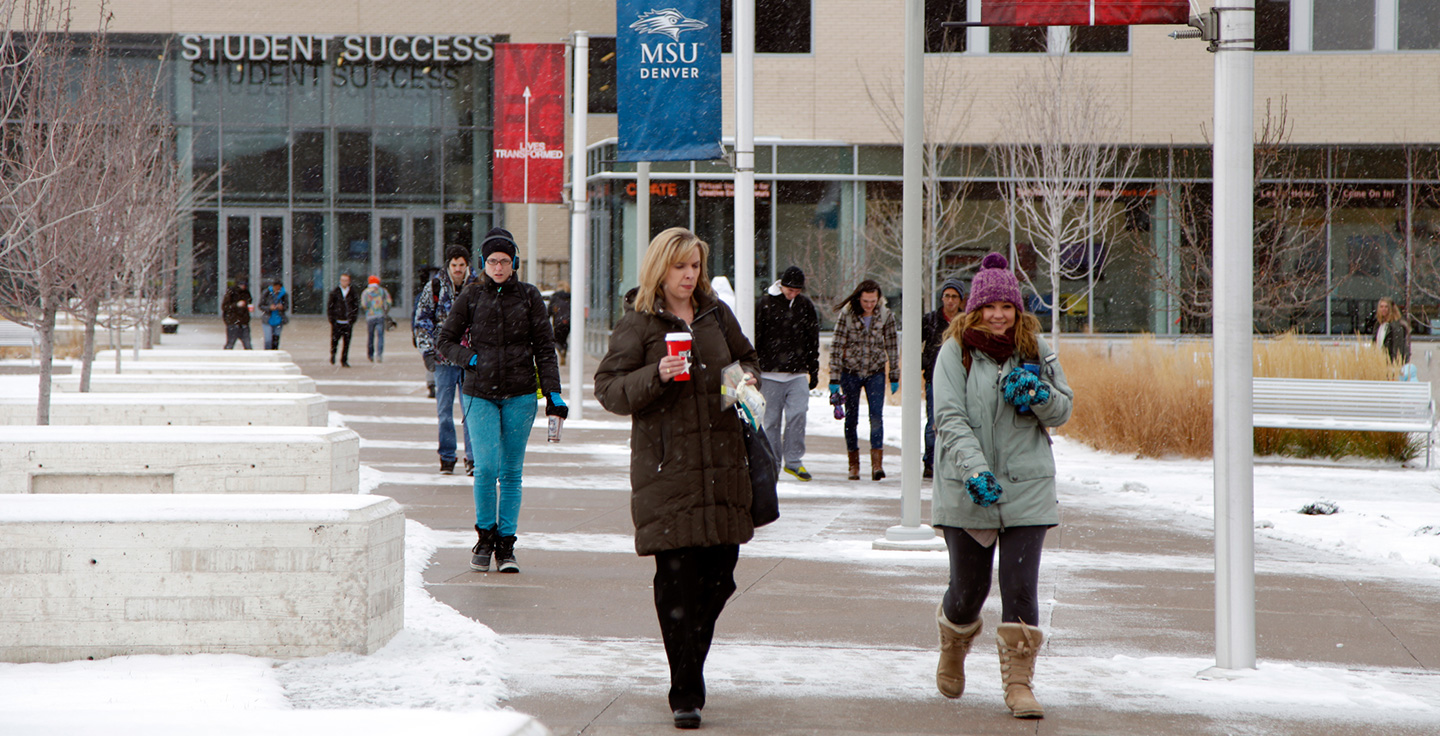 Students walking through Auraria Campus during the winter.