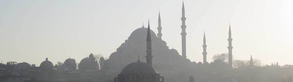 Photograph of hazy structures/buildings in the middle east.