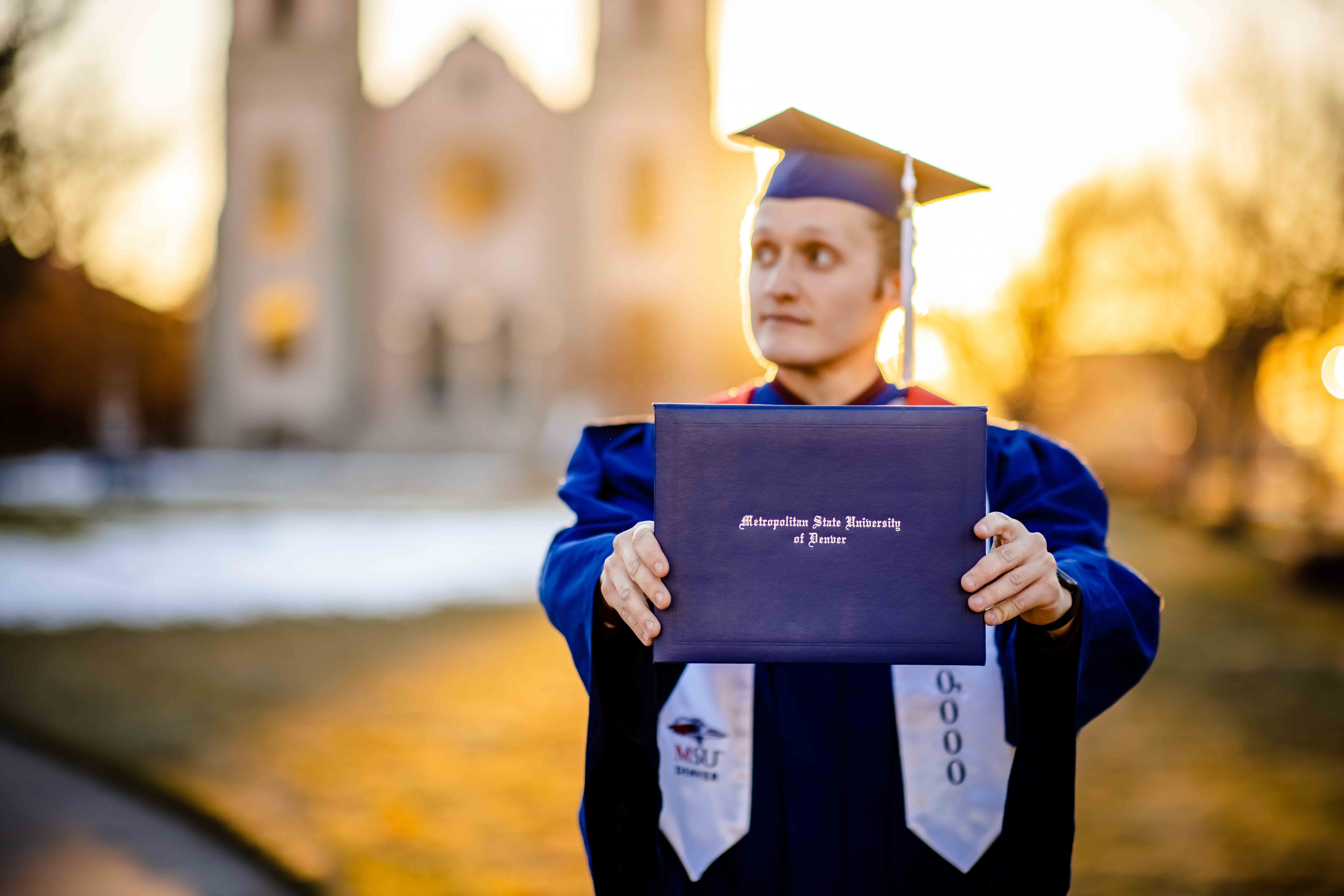 Branden Ingersoll with his diploma cover