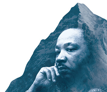 Martin Luther King Jr superimposed in front of a mountain