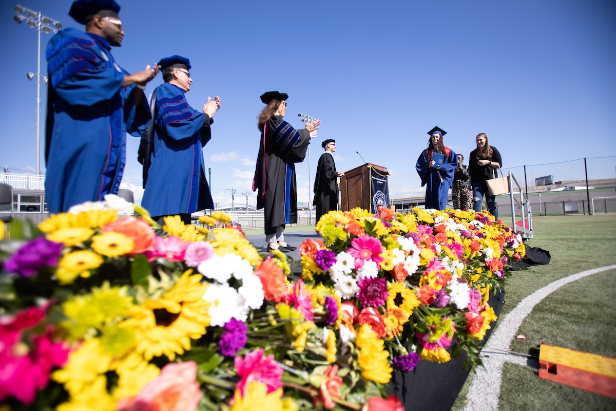 MSU Denver student walking across the stage at Spring 2021 Commencement