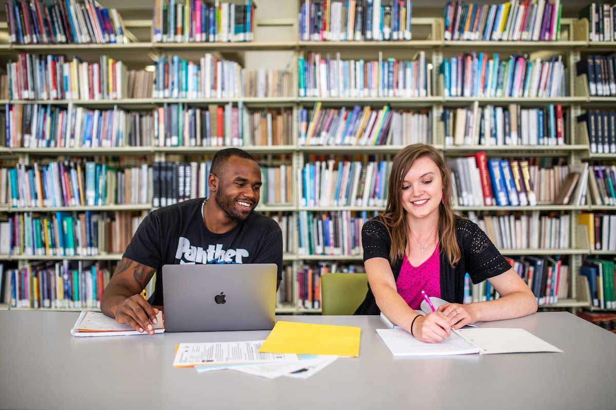 Students share a study space in the Auraria Library.