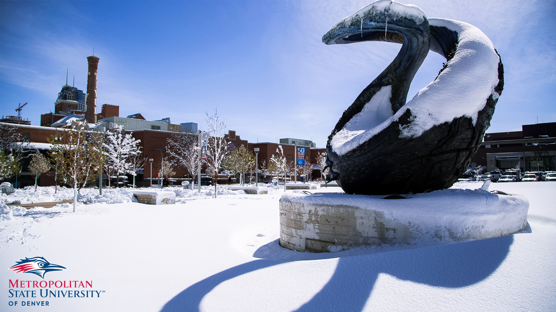 One World One Water sculpture covered in snow