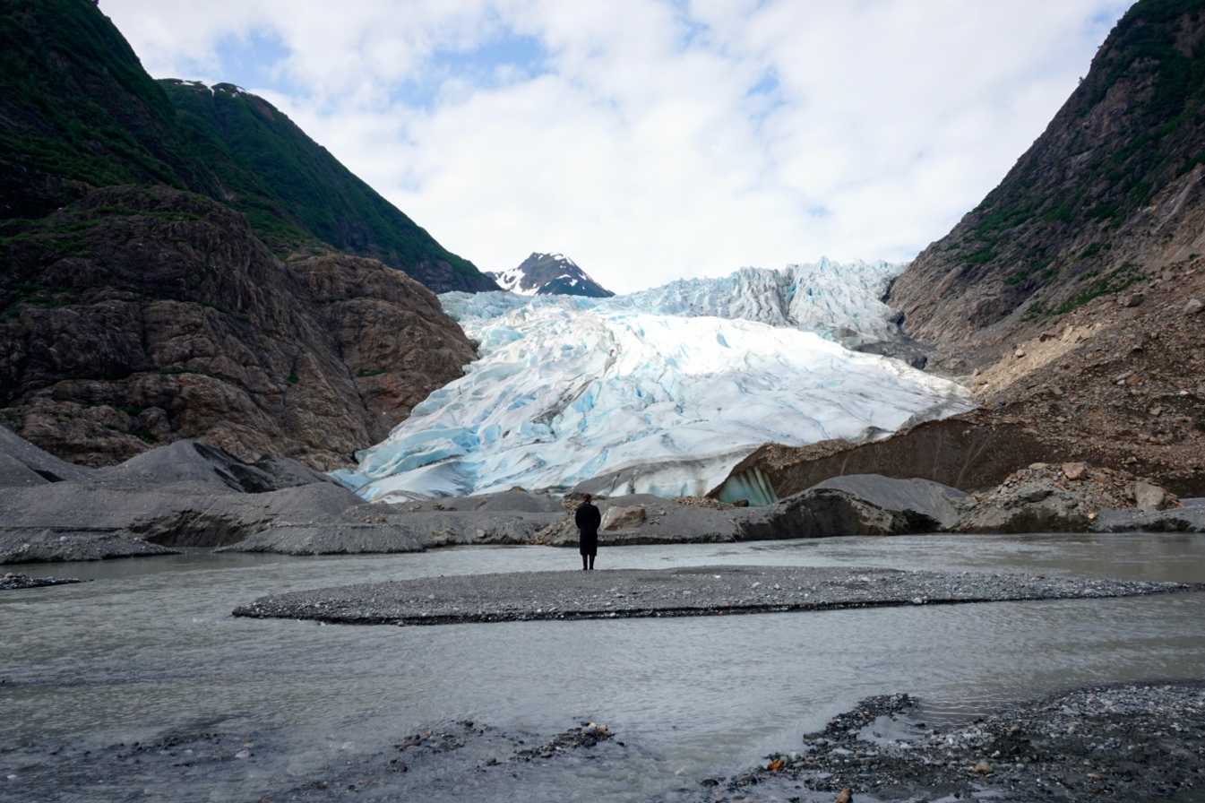 Student Alex looking at an Alaskan Glacier on a field course
