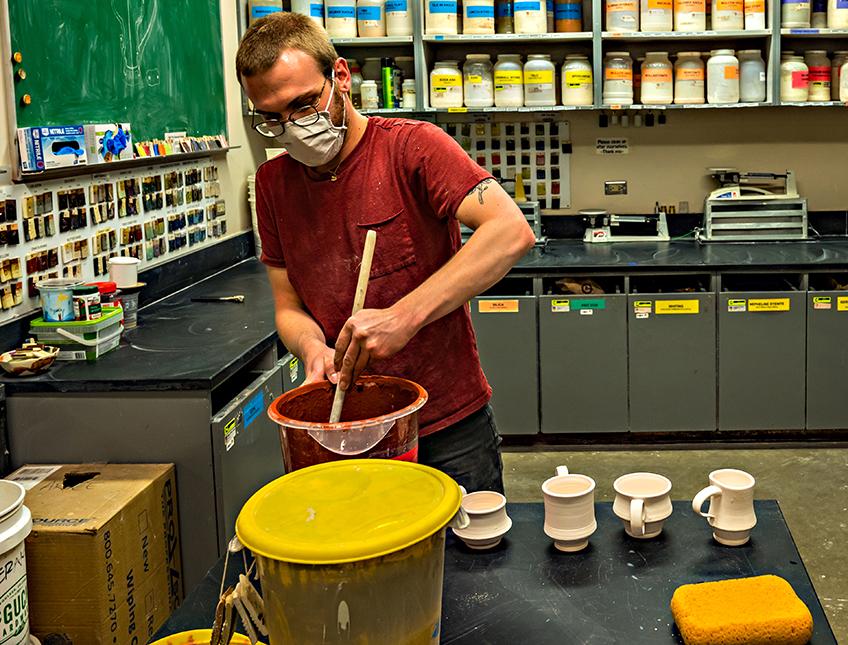 Mixing orange glaze for pottery