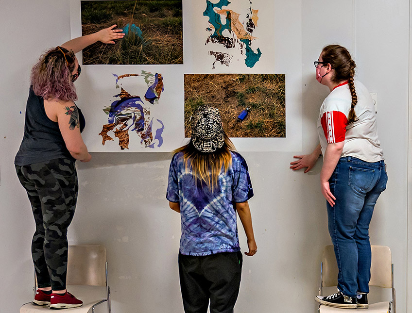 Students hanging images