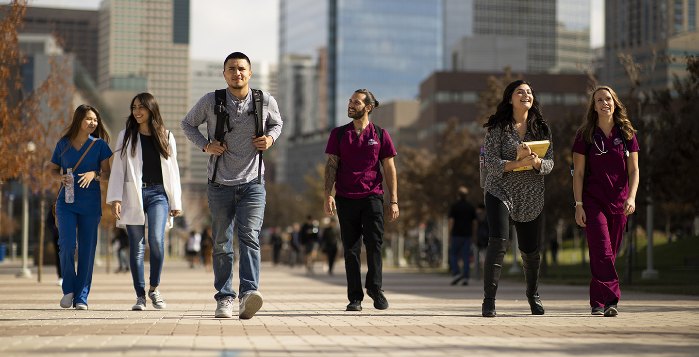 Health Profession Students walking outside on campus