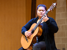 Classical guitarist on stage performing