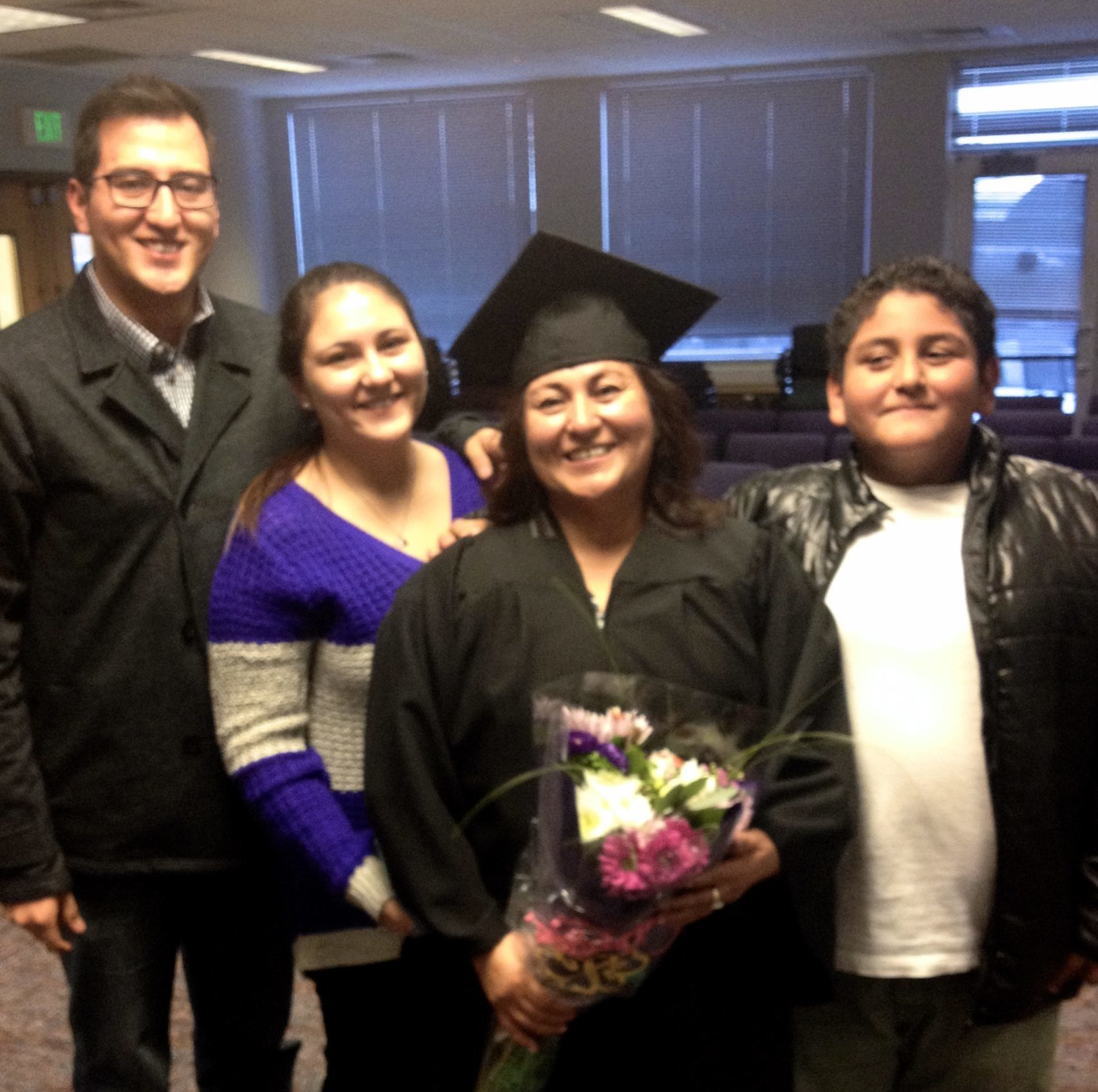 adult learner graduating with family